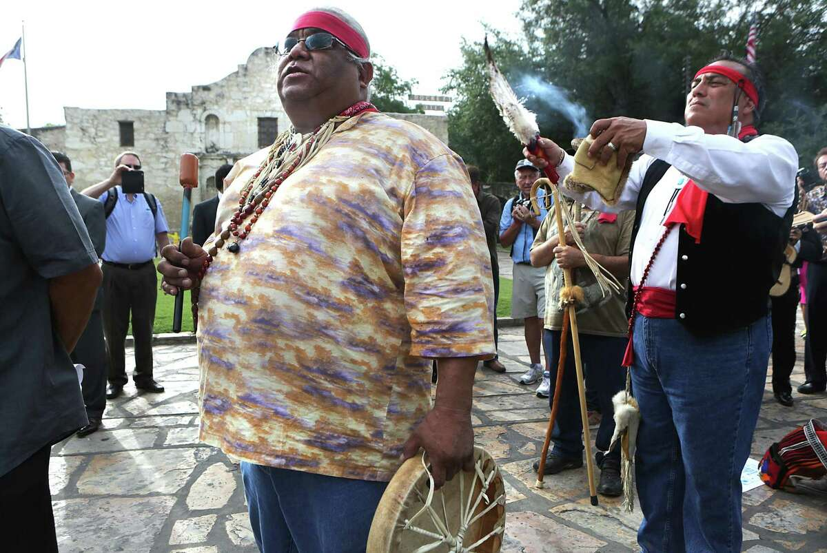 Epifanio Hernandez, left, and Adrian Ramirez, decendants of native americans, give blessing to the four corners of the earth as city leaders celebrate the announcement of the San Antonio's Spanish missions winning World Heritage Site status on Tuesday, July 7, 2015 in front of The Alamo.