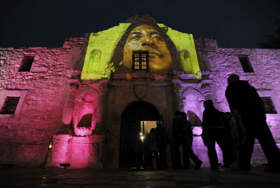 "A video showing indigenous and mestizo people of Texas is projected on the Alamo shrine in this 2009 photo. A Native American group says it has ""exhausted all of our efforts"" concerning buried human remains at the mission and battle site and will seek relief in a federal courtroom. The video was part of the art piece ""Enlight-tents,"" by Vaago Weiland and Laura Varela. Photo: BILLY CALZADA, STAFF / SAN ANTONIO EXPRESS-NEWS / gcalzada@express-news.net"