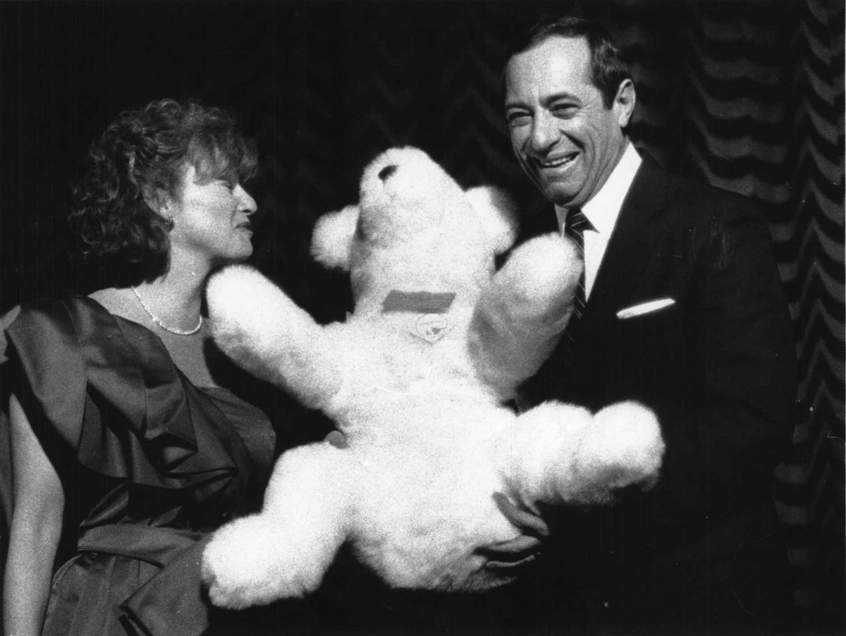 Palace Theatre, Albany - New York Governor Mario Cuomo presented with bear by Mimi Scott at AIDS benefit. March 09, 1986 (Ray Hoy/Times Union Archive)