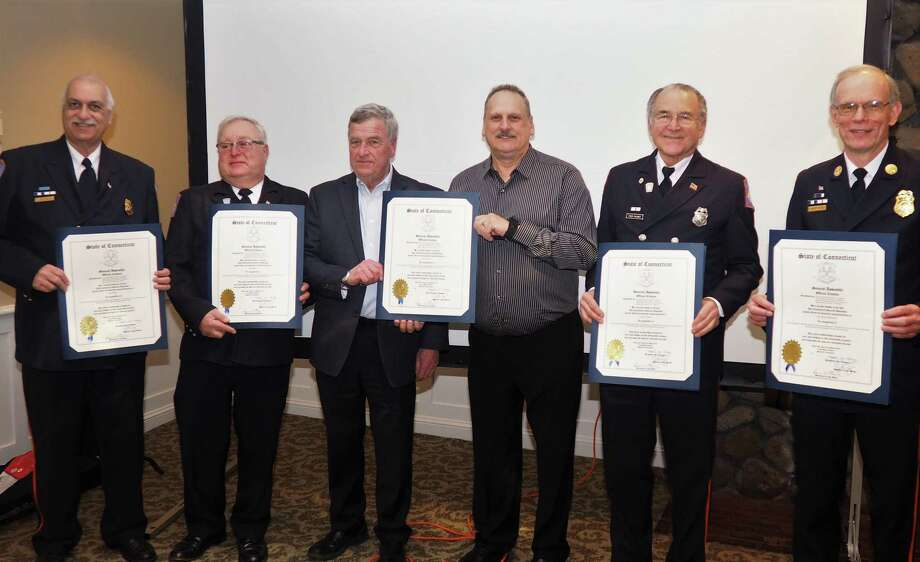 Six members of the Orange Volunteer Fire Department were honored by the Connecticut General Assembly Tuesday night for their service.  Together, the men have given 250 years of service to the fire department. From left to right, Peter Daniel, 40 years; David Gagel, 40 years; Ken Mitchell Jr., 45 years; George Geane, 25 years; Fred Palmer, 55 years; and Deputy Chief Charles Sherwood, 50 years. Photo: Contributed Photo