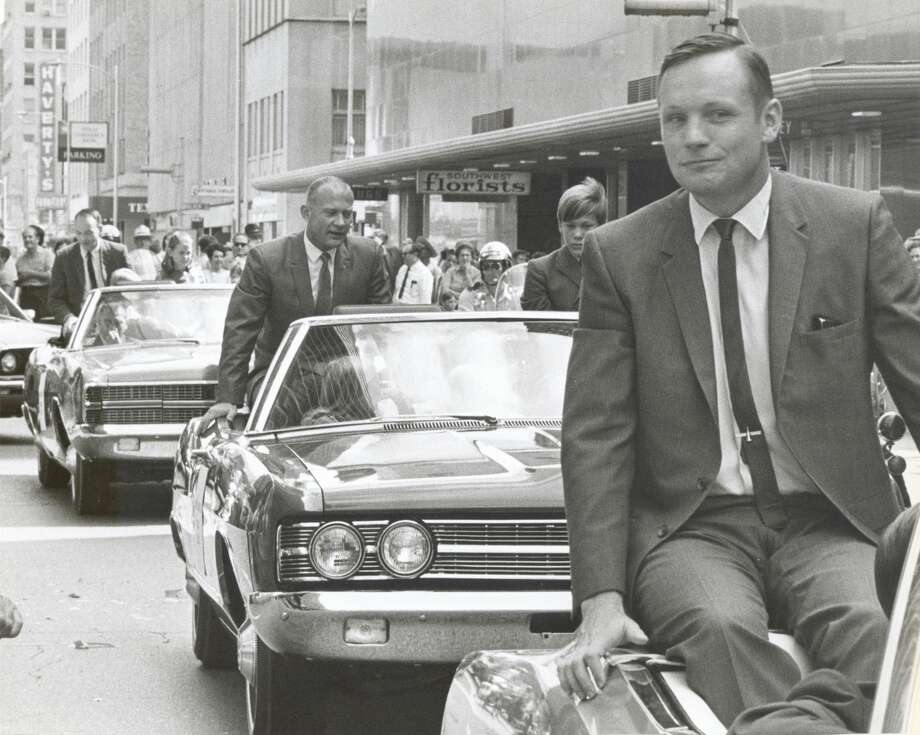 Apollo 11 Astronauts Neil A. Armstrong, right, and Edwin E. Aldrin Jr. and Michael Collins in a ticker-tape parade through downtown Houston in August 16, 1969 celebrating their moon landing. Photo: File