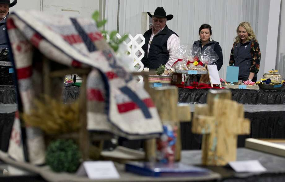 Onlookers view items before the non-livestock auction at the Montgomery County Fair and Rodeo, Monday, April 1, 2019, in Conroe. Photo: Jason Fochtman/Staff Photographer