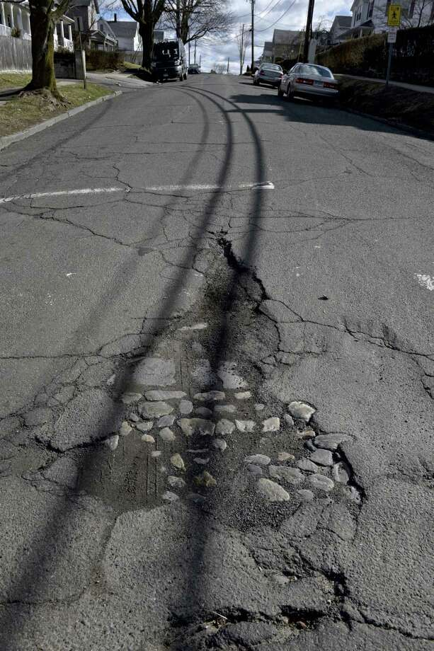 Potholes on Prospect Street, in Danbury, Conn, Saturday, March 16, 2019. Photo: H John Voorhees III / Hearst Connecticut Media / The News-Times