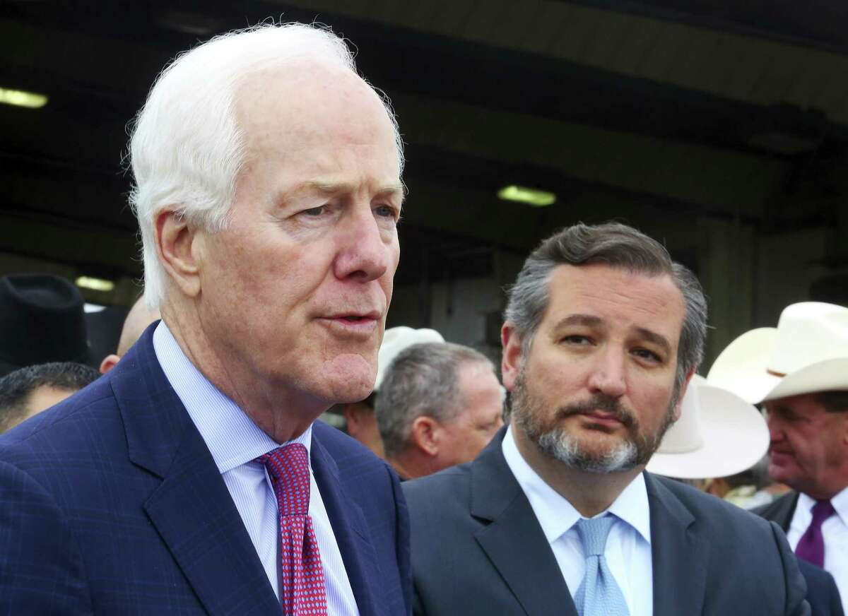 Sen. John Cornyn, left, R-Texas, and Sen. Ted Cruz, R-Texas, pose for pictures after a renaming ceremony at the Javier Vega Jr. Border Patrol Checkpoint on Wednesday, March 20, 2019, near Sarita, Texas. (Joel Martinez/The Monitor via AP)