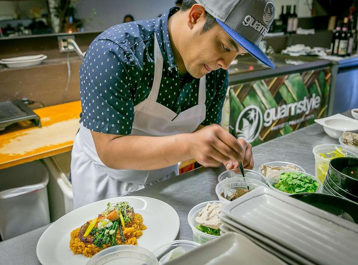 Chef Shawn Naputi plates Red Rice at Prubechu in San Francisco, Calif., on Saturday, April 5th, 2014.