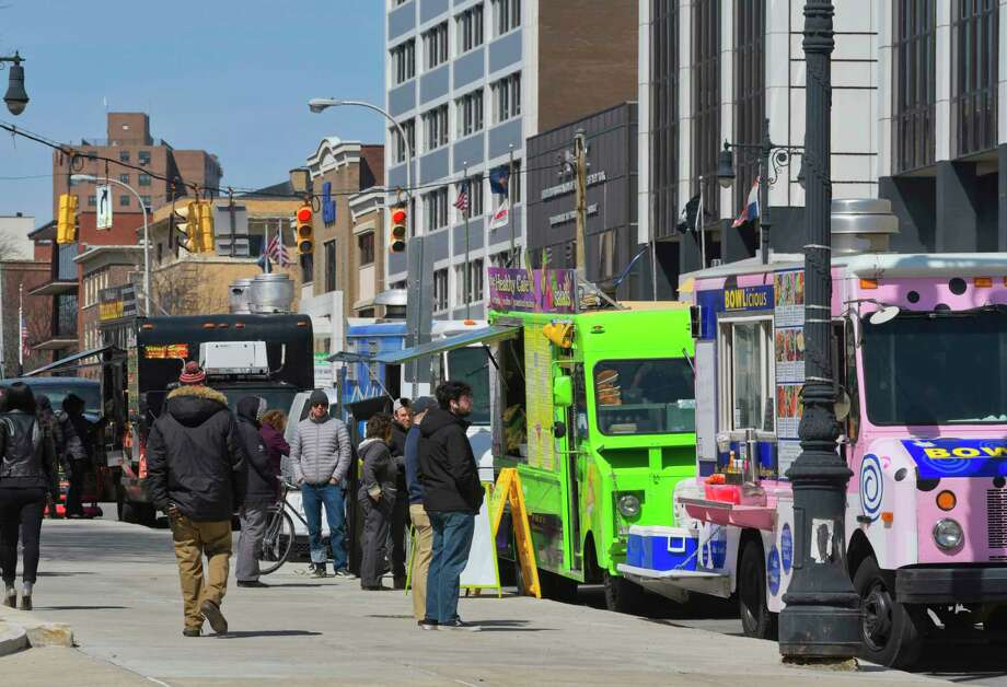 Spring has officially begun. The food trucks are back! People come out to buy lunch from various food vendors along Washington Ave. on Tuesday, April 2, 2019, in Albany, N.Y.  (Paul Buckowski/Times Union) Photo: Paul Buckowski, Albany Times Union / (Paul Buckowski/Times Union)