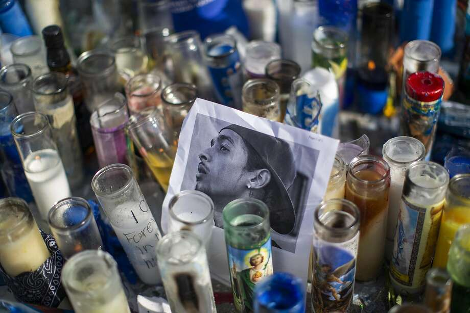 A photo of rapper Nipsey Hussle, 33, is seen among candles as people gather to mourn his death in Los Angeles. The Grammy-nominated artist was gunned down in broad daylight. Photo: David McNew / Getty Images