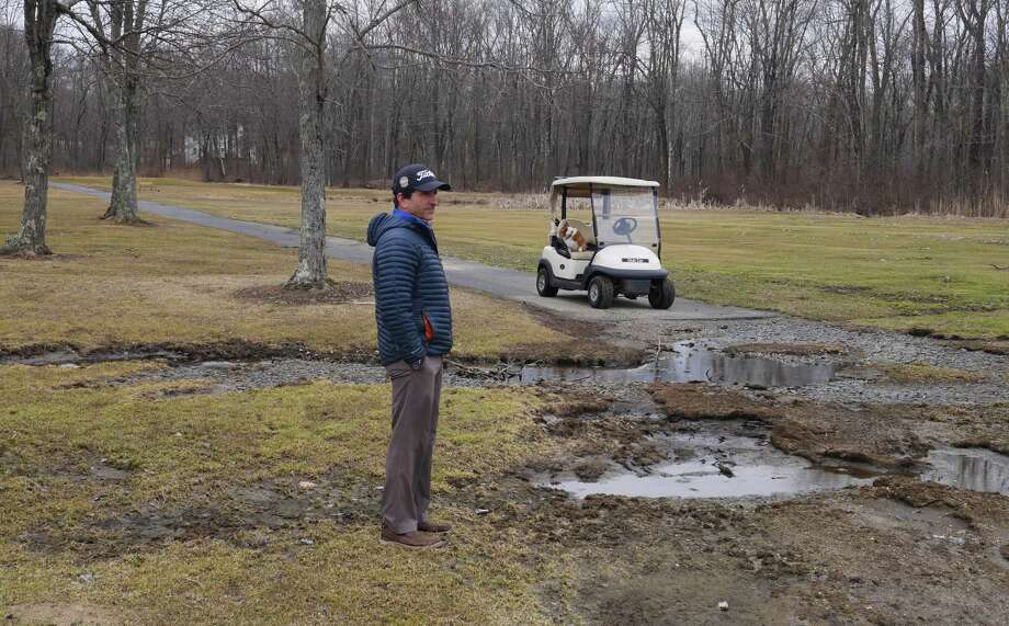 Golf pro Frank Sergiovanni shows damage done to the Ridgefield Golf Course. Photo: Macklin Reid / Hearst Connecticut Media