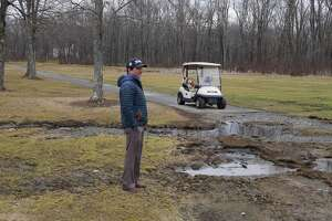 Golf pro Frank Sergiovanni shows damage done to the Ridgefield Golf Course.