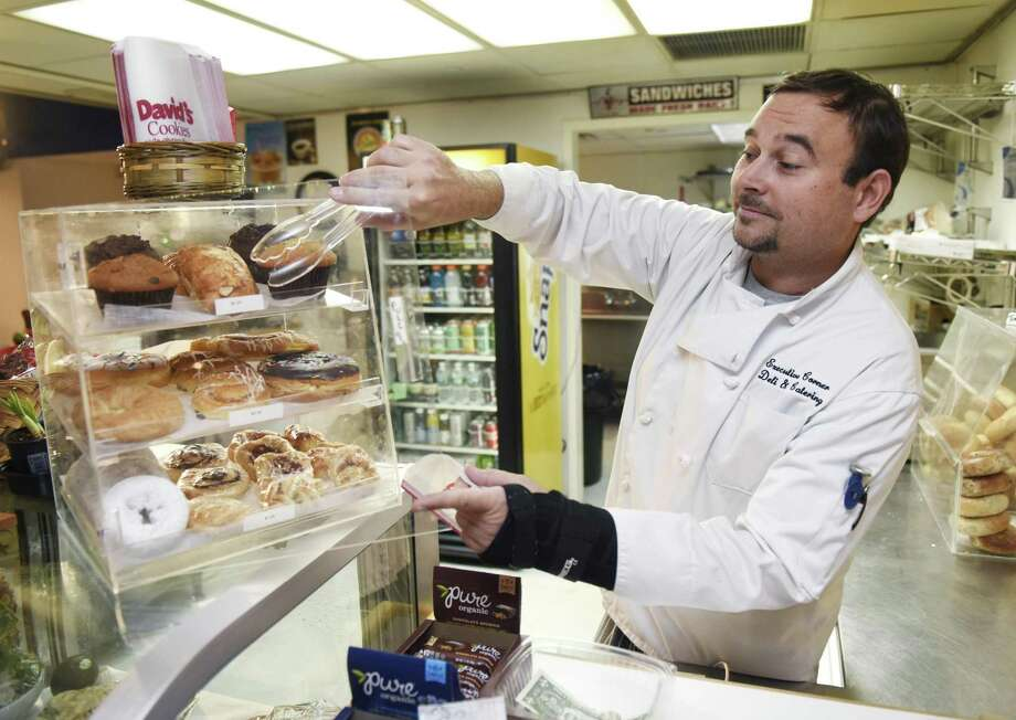 Executive Corner Deli & Catering owner Kevin Allmashy gets a pastry at the Library Café at the Greenwich Library in Greenwich, Conn. Tuesday, April 2, 2019. Elton's Café recently ceased operation after 19 years at Greenwich Library and the space will now be run by Byram's Executive Corner Deli & Catering. Photo: Tyler Sizemore / Hearst Connecticut Media / Greenwich Time