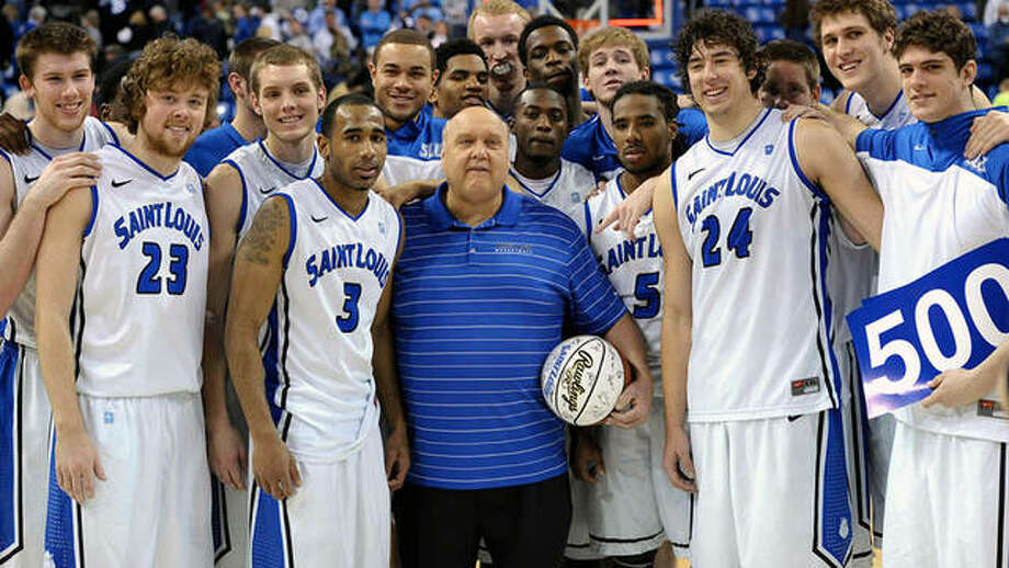 The late Rick Majerus, center, poses with members of his 2011-2012 Saint Louis University basketball team after a victory over Illinois-Springfield, which was Majeris' 500 career coaching victory. Photo: Billikens Athletics