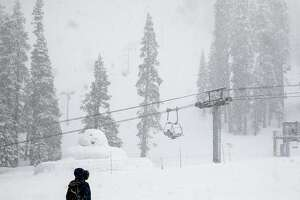 Moderate snow falls over the slopes at Sierra-at-Tahoe Resort in Twin Bridges, Calif. Tuesday, April 2, 2019.