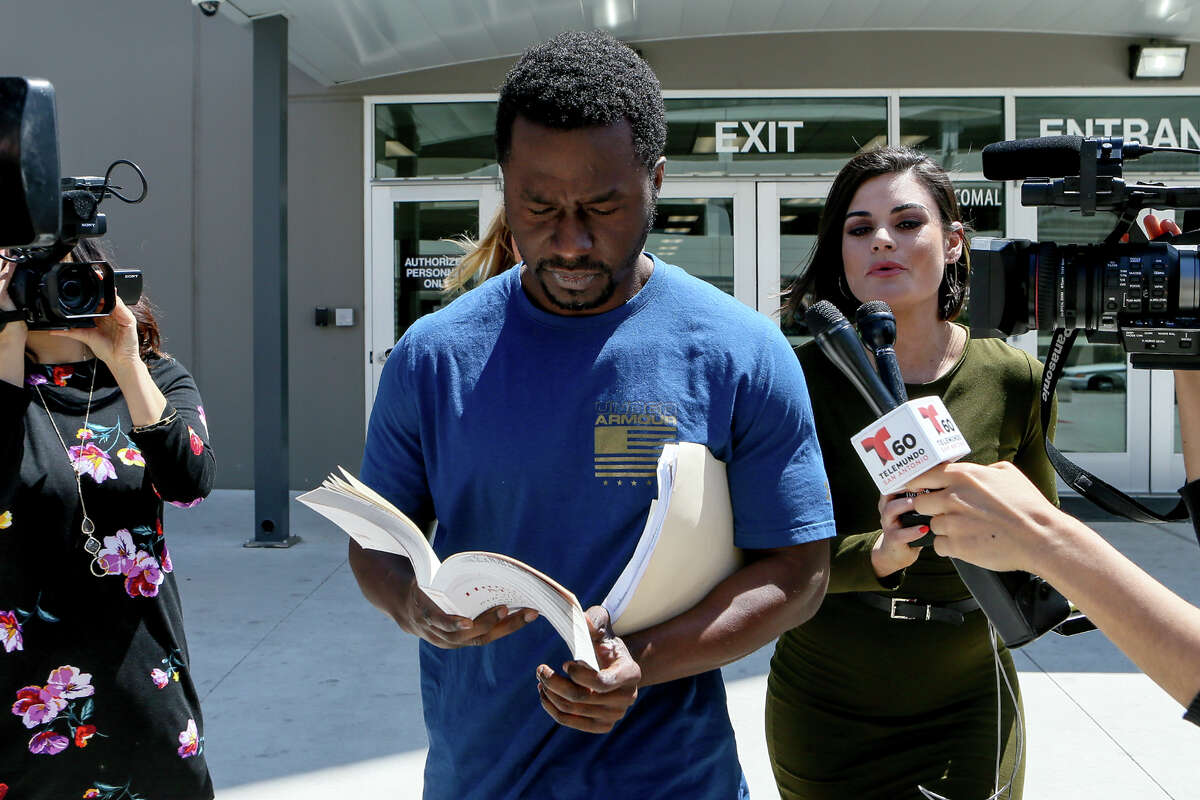 Andre McDonald, left, is released from the new Justice Intake Center at the Bexar County Jail on Tuesday, April 2, 2019, after posting bond of $300,000. McDonald is charged with tampering in his wife's disappearance last month.