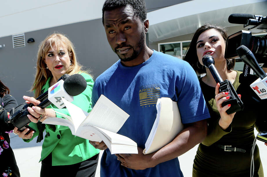 Andre McDonald, left, is released from the new Justice Intake Center at the Bexar County Jail on Tuesday, April 2, 2019, after posting bond of $300,000.  McDonald is charged with tampering in his wife's disappearance last month. Photo: Marvin Pfeiffer / Express-News 2019