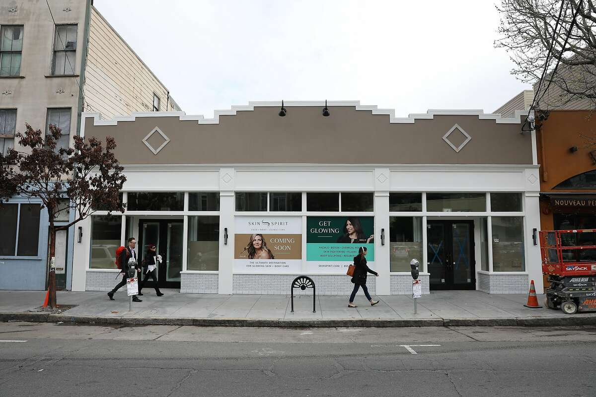 Signage for a new spa coming soon at a retail store that used to house Real Food grocery store which closed in 2003 is seen on Wednesday, March 27, 2019 in San Francisco, Calif.