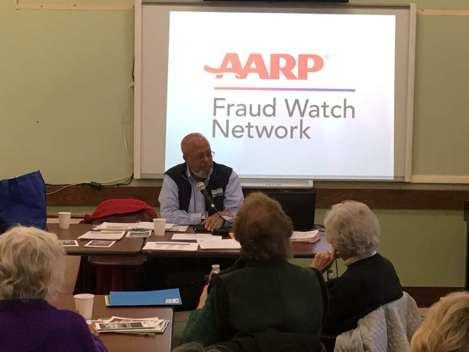 AARP volunteer Byron Peterson tells Greenwich seniors how to avoid becoming victims of financial crime at a panel discussion at the Greenwich Senior Center. Photo: / Robert Marchant / Hearst Media