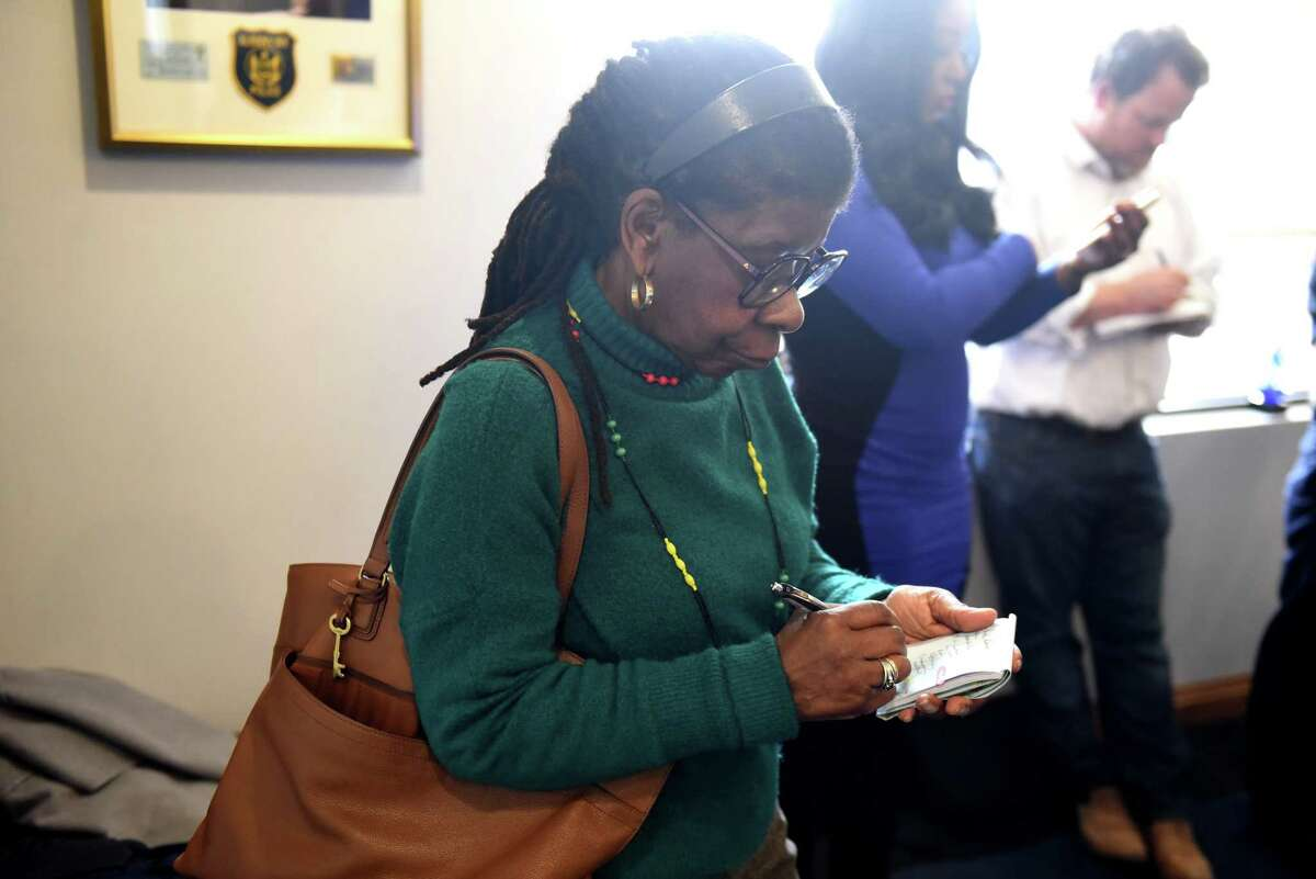 Alice Green, executive director of the Center for Law and Justice, takes notes during a press conference to address an alleged police assault of two black men by Albany police officers on Tuesday, April 2, 2019, in Albany, N.Y. The incident took place on March 16 after police responded to a call for loud music. (Will Waldron/Times Union)
