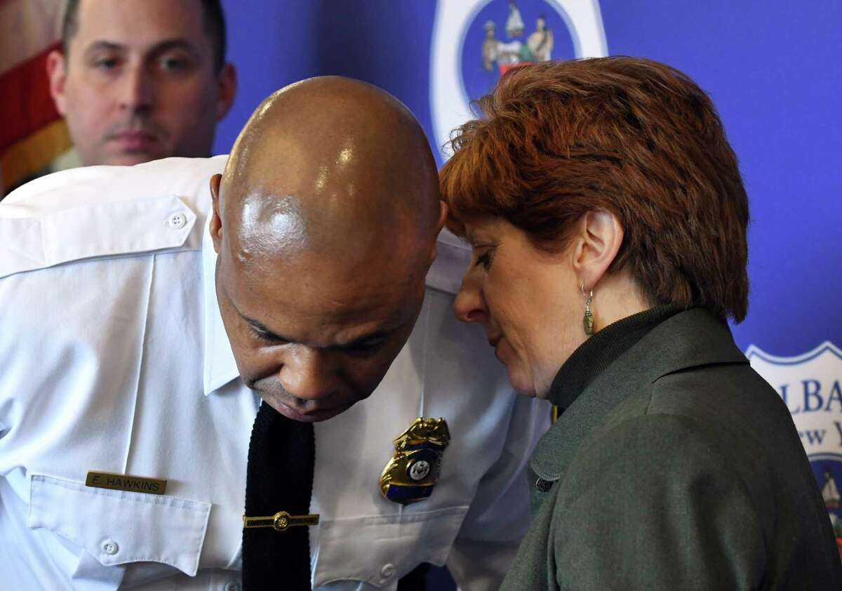 Albany Police Chief Eric Hawkins, left, listens to Mayor Kathy Sheehan, right, during a press conference to address an alleged assault by Albany police officers on Tuesday, April 2, 2019, at the police headquarters in Albany, N.Y. The incident took place on March 16 after police responded to a call for loud music. (Will Waldron/Times Union)