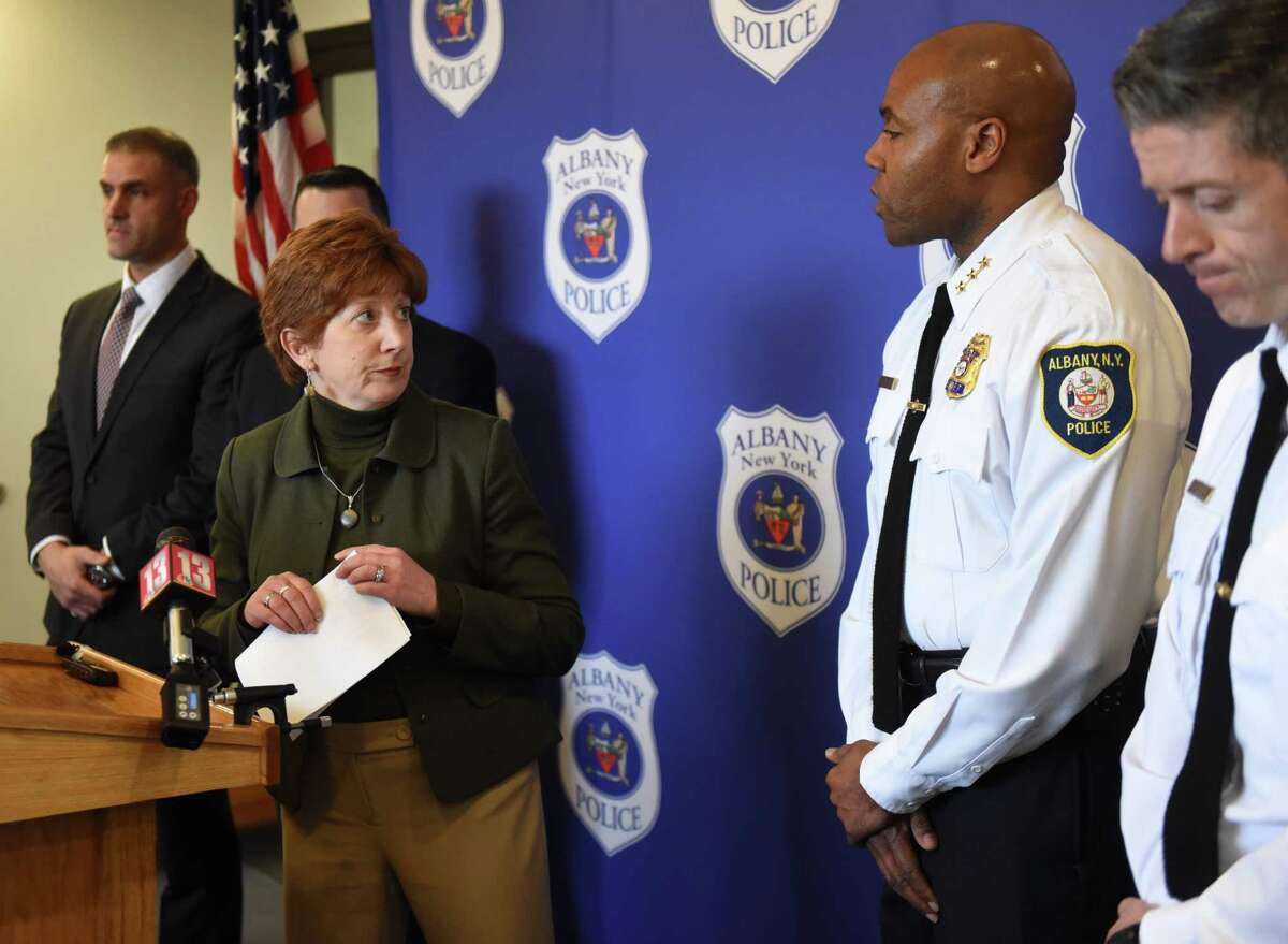 Mayor Kathy Sheehan, left, looks to Albany Police Chief Eric Hawkins, right, after speaking during a press conference to address an alleged assault by Albany police officers on Tuesday, April 2, 2019. Hawkins is a finalist for a job leading the police force in Akron, Ohio.