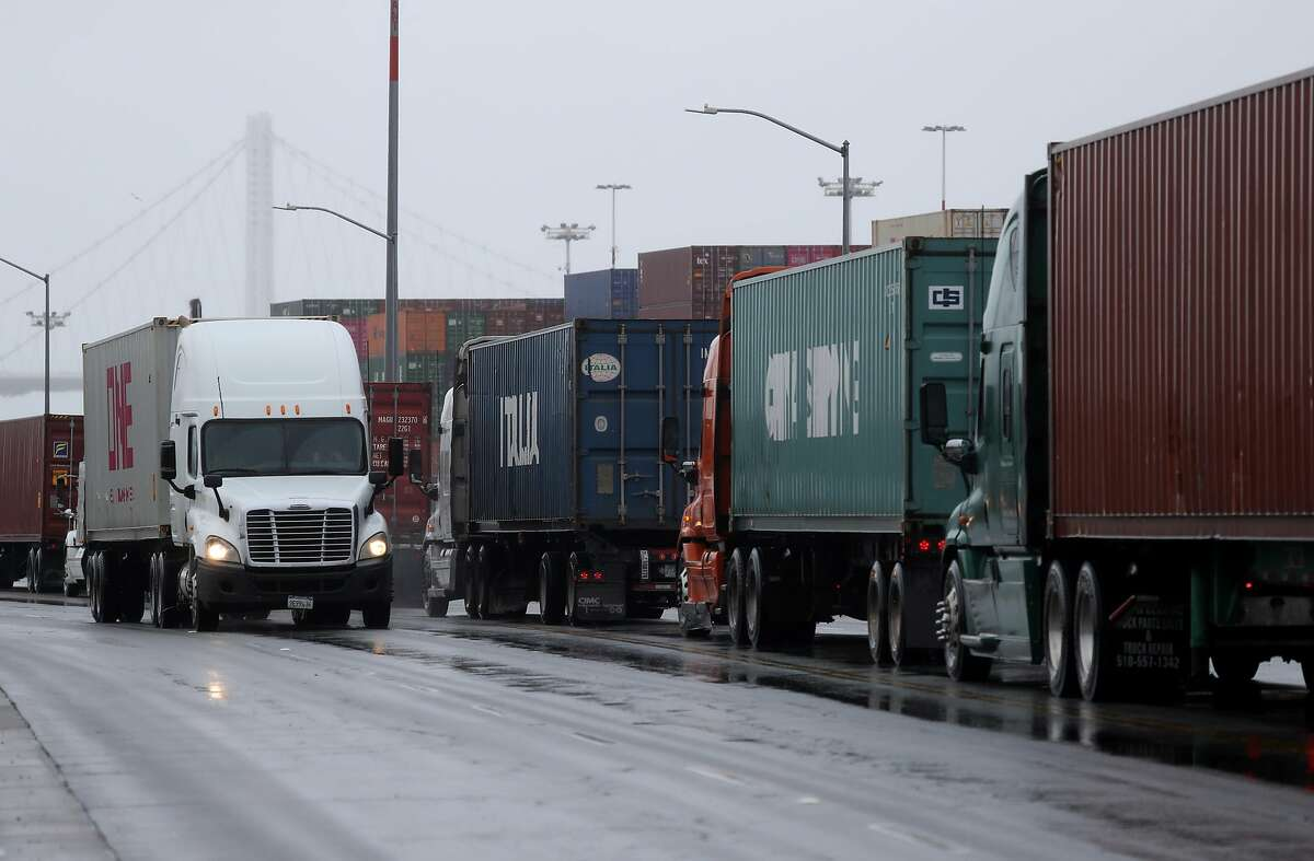 OAKLAND, CALIFORNIA - MARCH 06: Trucks carrying shipping containers wait in line to enter a shipping berth at the Port of Oakland on March 06, 2019 in Oakland, California. According to the U.S. Commerce Department, the trade deficit surged 12.5 percent from 2017 to $891.3 billion, a record high. (Photo by Justin Sullivan/Getty Images)