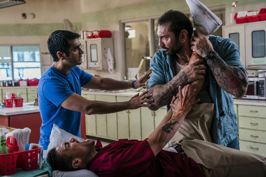 Kumail Nanjiani as Stu, Dave Bautista as Vic, and Rene Moran as Amo in 'Stuber.' (Hopper Stone/SMPSP/Twentieth Century Fox)