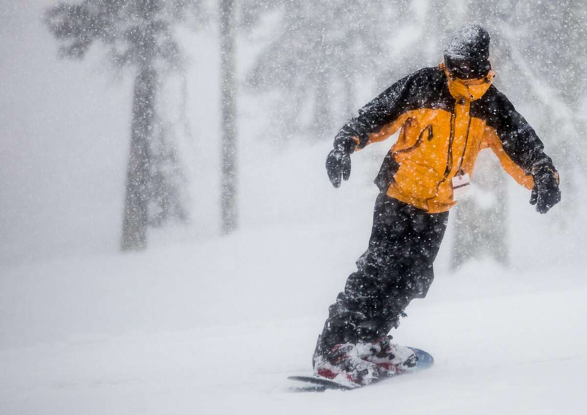 A snowboarder rides down the mountain during a moderate snowfall at Sierra-at-Tahoe Resort in Twin Bridges, Calif. Tuesday, April 2, 2019.