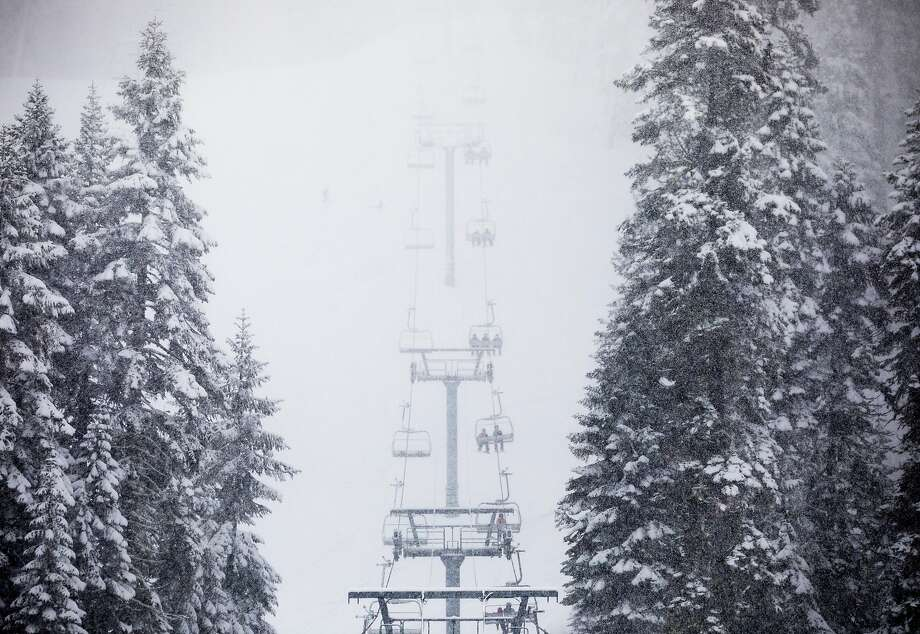 FILE — Skiiers and snowboarders ride a ski lift up the mountain during a moderate snowfall at Sierra-at-Tahoe Resort in Twin Bridges, Calif. Tuesday, April 2, 2019. Photo: Jessica Christian / The Chronicle