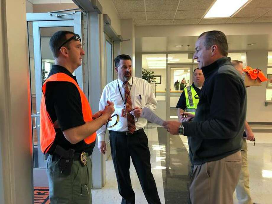 Edwardsville Police Department Sgt. Matthew Briehan, left, speaks to EHS Assistant Principal Vince Schlueter and EHS Principal Dennis Cramsey before the simulated active intruder training. Photo: By Julia Biggs | The Intelligencer