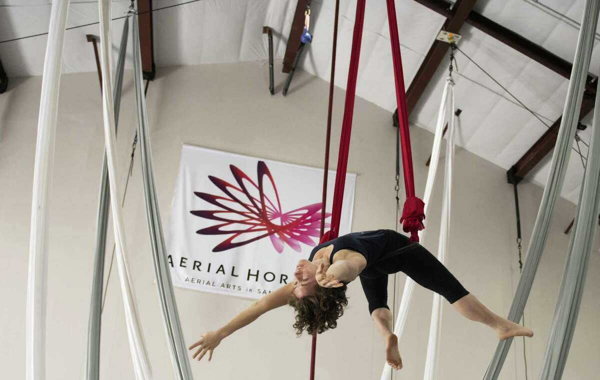 """Lauren Breunig rehearses at Aerial Horizon, which is developing an international reputation for its work. It is presenting its first show in its new space, """"Divulge."""""""