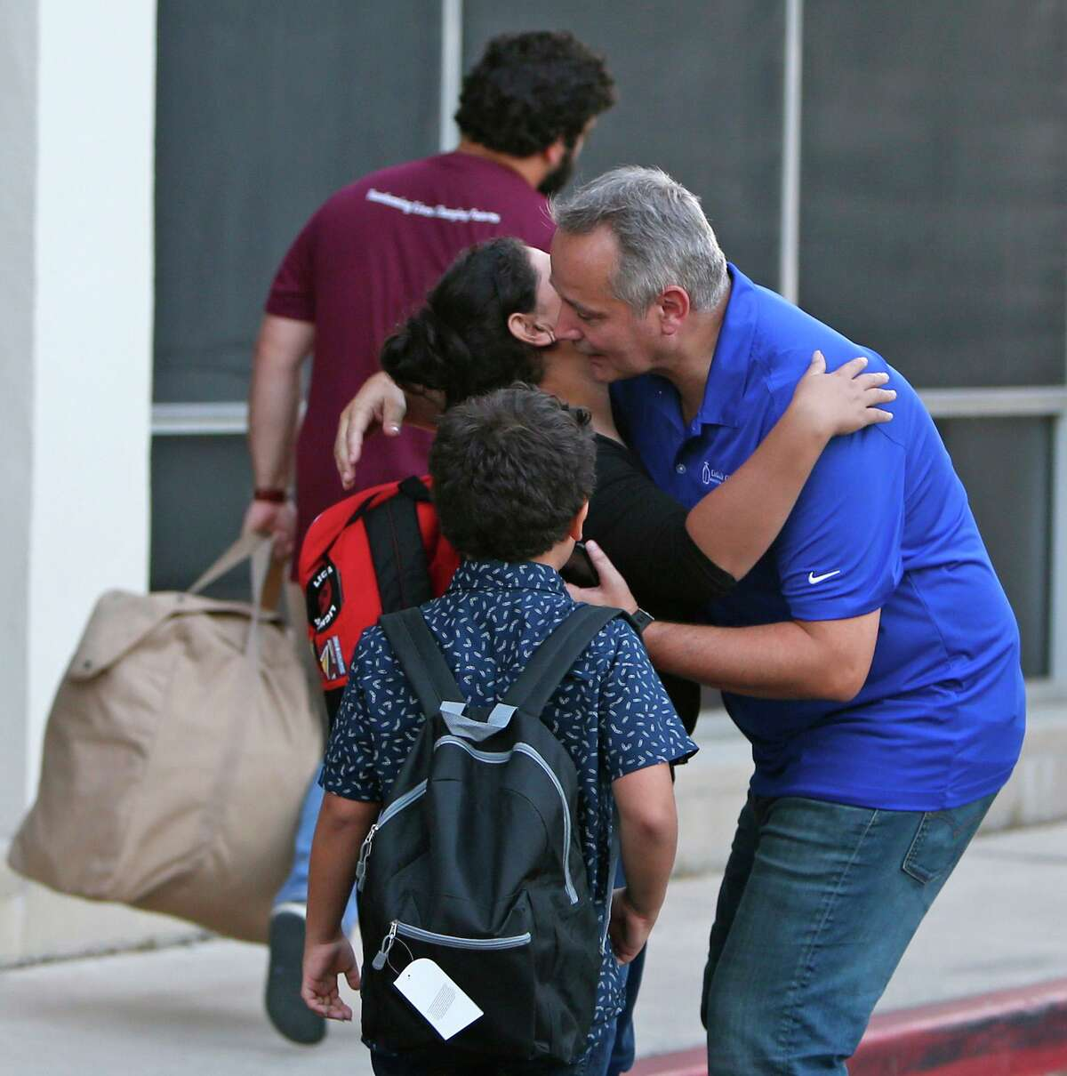 Director of Catholic Charities Antonio Fernandez says goodbye to an immigrant family outside of Catholic Charities in 2018. Fernandez and his team are preparing for an increase of refugees under the Biden administration.