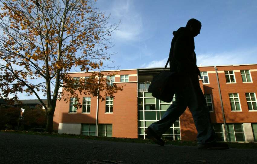 A student walks in front of the science building on the campus of Seattle Pacific University on Wednesday November 1, 2006 in Seattle, Wash. Joshua Trujillo / Seattle Post-Intelligencer