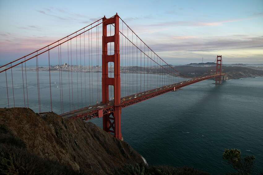 A view of the Golden Gate Bridge and sweeping San Francisco skyline beyond.