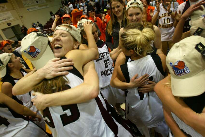 On March 14, 2005 Seattle Pacific University player Carli Smith (facing left) hand teammates rejoice after they beat the Chico State Wildcats at Seattle Pacific University. Final score 85-70.