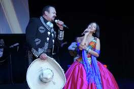 LOS ANGELES, CALIFORNIA - APRIL 01: Recording artists Pepe Aguilar (L) and Angela Aguilar perform onstage during Pepe Aguilar and Family 'Jaripeo Sin Fronteras 2019' press conference at Los Angeles Theatre on April 01, 2019 in Los Angeles, California.