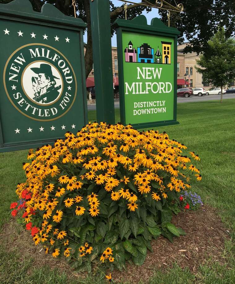 The New Milford Garden Club has planned, planted and cared for numerous landscaping projects and gardens throughout town, including this one at the south end of the Village Green. Photo: Contributed Photo / Contributed Photo / The News-Times Contributed