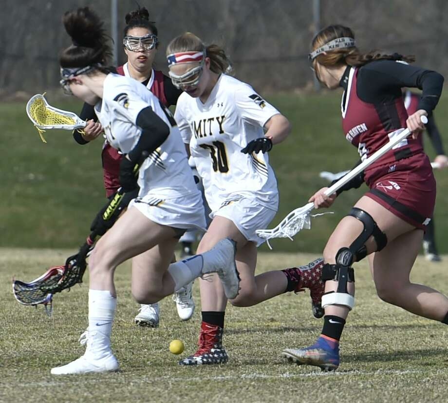 Woodbridge, Connecticut - Tuesday, April 2, 2019: Amity H.S. girls lacrosse vs. North Haven H.S. Tuesday afternoon at Amity H.S. in Woodbridge. Photo: Peter Hvizdak / Hearst Connecticut Media / New Haven Register