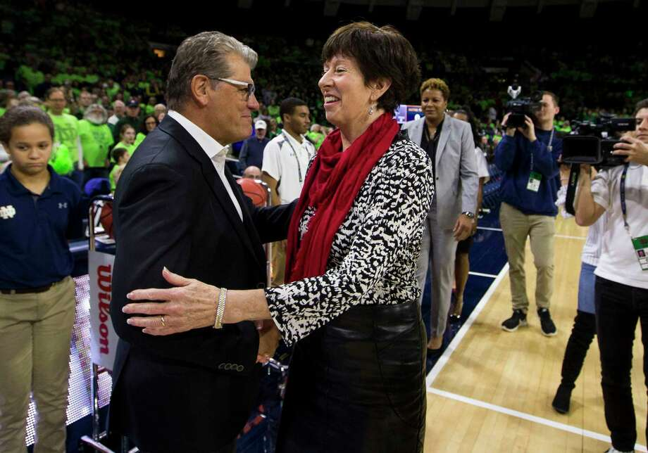 UConn coach Geno Auriemma, left, and Notre Dame head coach Muffet McGraw shake hands an 89-71 Huskies win on Dec. 2 in South Bend, Ind. Photo: Robert Franklin / Associated Press / FR17139 AP