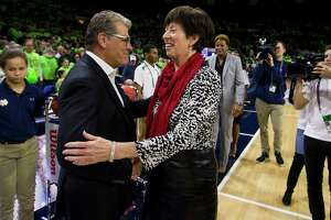 UConn coach Geno Auriemma, left, and Notre Dame head coach Muffet McGraw shake hands an 89-71 Huskies win on Dec. 2 in South Bend, Ind.