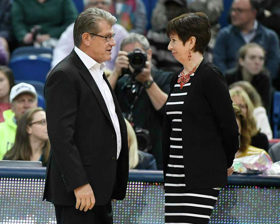 UConn coach Geno Auriemma, left, talks with Notre Dame head coach Muffet McGraw before a game on Dec. 3, 2017 in Hartford. Photo: Jessica Hill / Associated Press / AP2017