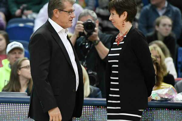 UConn coach Geno Auriemma, left, talks with Notre Dame head coach Muffet McGraw before a game on Dec. 3, 2017 in Hartford.