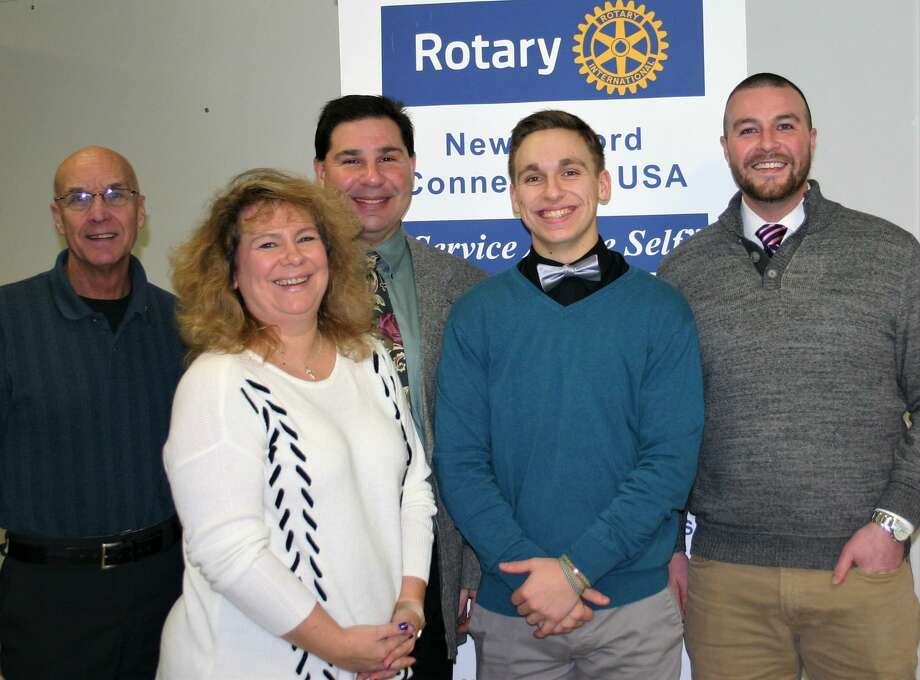 The Rotary Club of New Milford recently presented the January Student of the Month Award to New Milford High School senior Timothy Cianciulo. Timothy received high and highest honors throughout high school and received the Business Award his freshman year. He played NMHS Varsity baseball for four years and has been captain of the team and participated in two years of indoor track. He coaches youth baseball and participates in volunteer activities through the National and Math Honor Societies and volunteers at the Bridgewater Country Fair. Timothy will attend UMass Boston, majoring is healthy sciences and sports management with a goal of becoming a physician's assistant. He is shown above with, from left to right, Rotarian Tom McSherry, Timothy's parents, Kim and David Cianciulo, and NMHS teacher Rick Casagrande. Photo: Courtesy Of Rotary Club Of New Milford / The News-Times Contributed