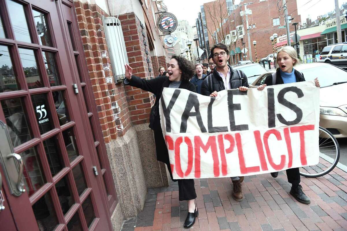 Yale University students walk to the building housing Yale Investments office in New Haven after disrupting a talk about personal finance featuring Yale University's Chief Investment Officer David Swensen at Linsly-Chittenden Hall in New Haven on April 2, 2019. Protesters seek to have the Yale University endowment divest of Puerto Rican debt and investments in the fossil fuel industry.