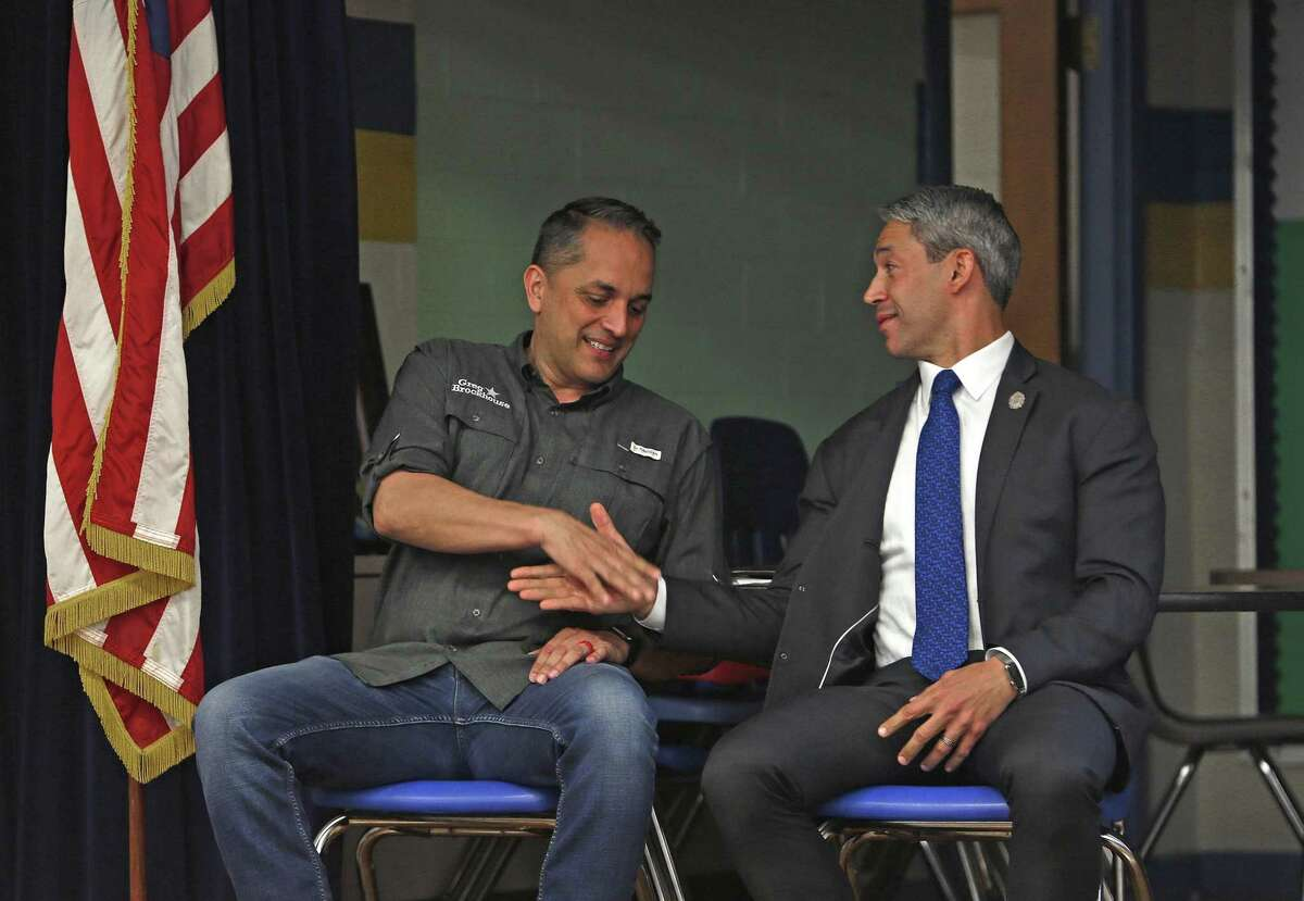 Mayor Ron Nirenberg and Greg Brockhouse finally acknowledge each other as they prepare to begin the mayoral forum at Highland Hill Elementary School on Monday April 1 , 2019.