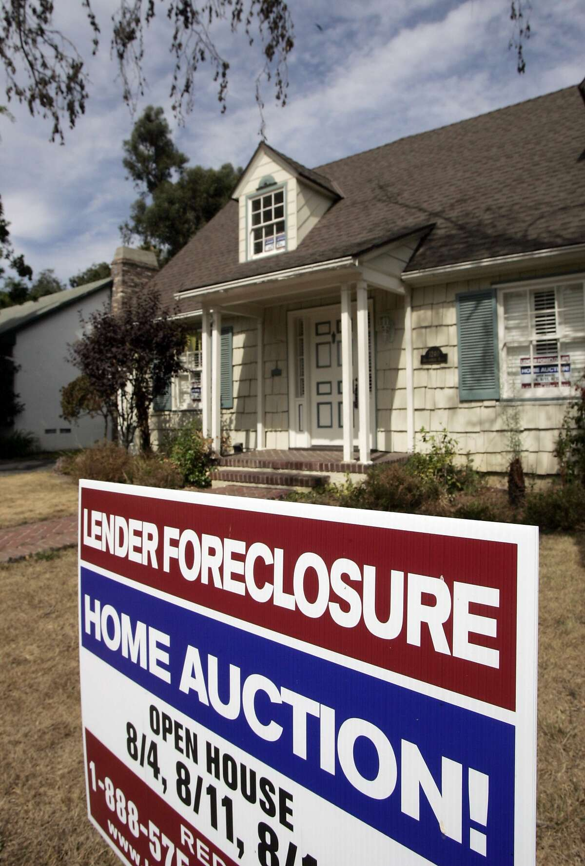 A home is advertised for sale at a foreclosure auction in Pasadena, Calif., in this Aug. 14, 2007 file photo. The number of U.S. households faced with losing their homes to foreclosure jumped 32 percent in April compared with the same month last year, with Nevada, Florida and California showing the highest rates, according to data released Wednesday May 13, 2009. (AP Photo/Reed Saxon, file)