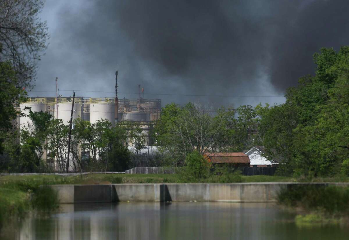A plume of smoke rises over the site of chemical fire at the KMCO plant Tuesday, April 2, 2019, in Crosby, Texas. A shelter-in-place was ordered for people living within one-mile of the plant.