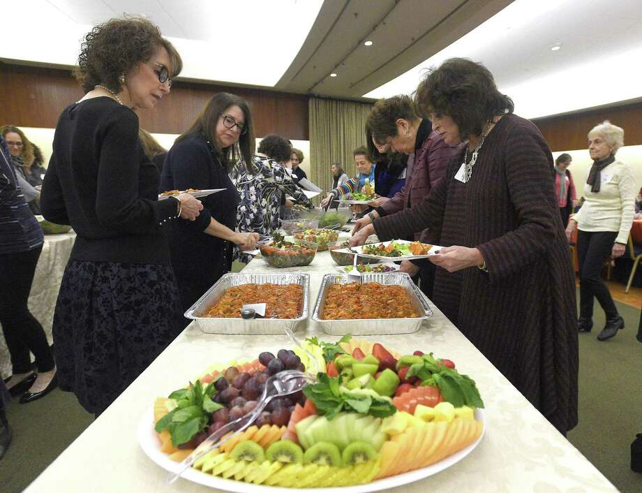 Guests attend a communitywide women's Seder at Temple Beth El Tuesday, April 2, 2019 in Stamford, Connecticut. Last year, more than 130 women (young, old and intergenerational) attended the event. This year, over 200, including a group from the Sisterhood of Saalam Shalom attended the dinner. Guests took home a beautifully designed Haggadah, whichl contain prayers and readings that underscore the Seder's theme and underlying messages. Photo: Matthew Brown / Hearst Connecticut Media / Stamford Advocate