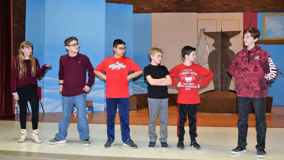"""A talented cast of student performers from Branford's Walsh Intermediate School (WIS) is preparing to tell a timely story of home, identity, and tolerance in the musical, """"Honk!"""" From left are Jade Bocciarelli as Ida; Lucas Johnson as Drake; Alex Lenox, Michael Steinman, Dylan Kealey and Connor Zeitlin (missing) as the ducklings; and Ryder Kropiwnicki, who plays the role of Ugly. Photo: Contributed Photo /"""