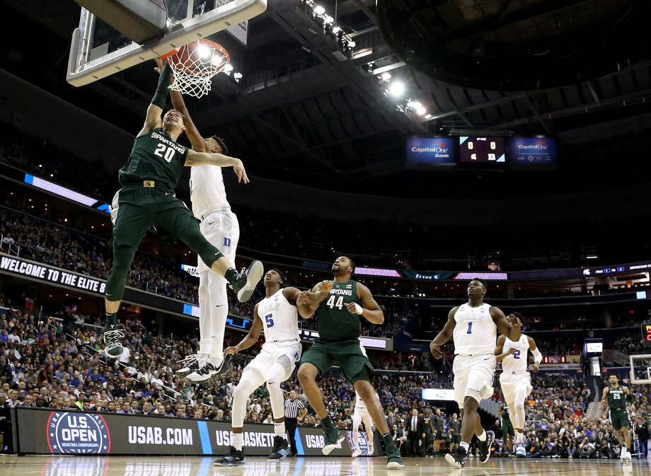 Michigan State's Matt McQuaid dunks against Duke during the East Region final of the 2019 NCAA Tournament in Washington, D.C. Photo: Getty Images