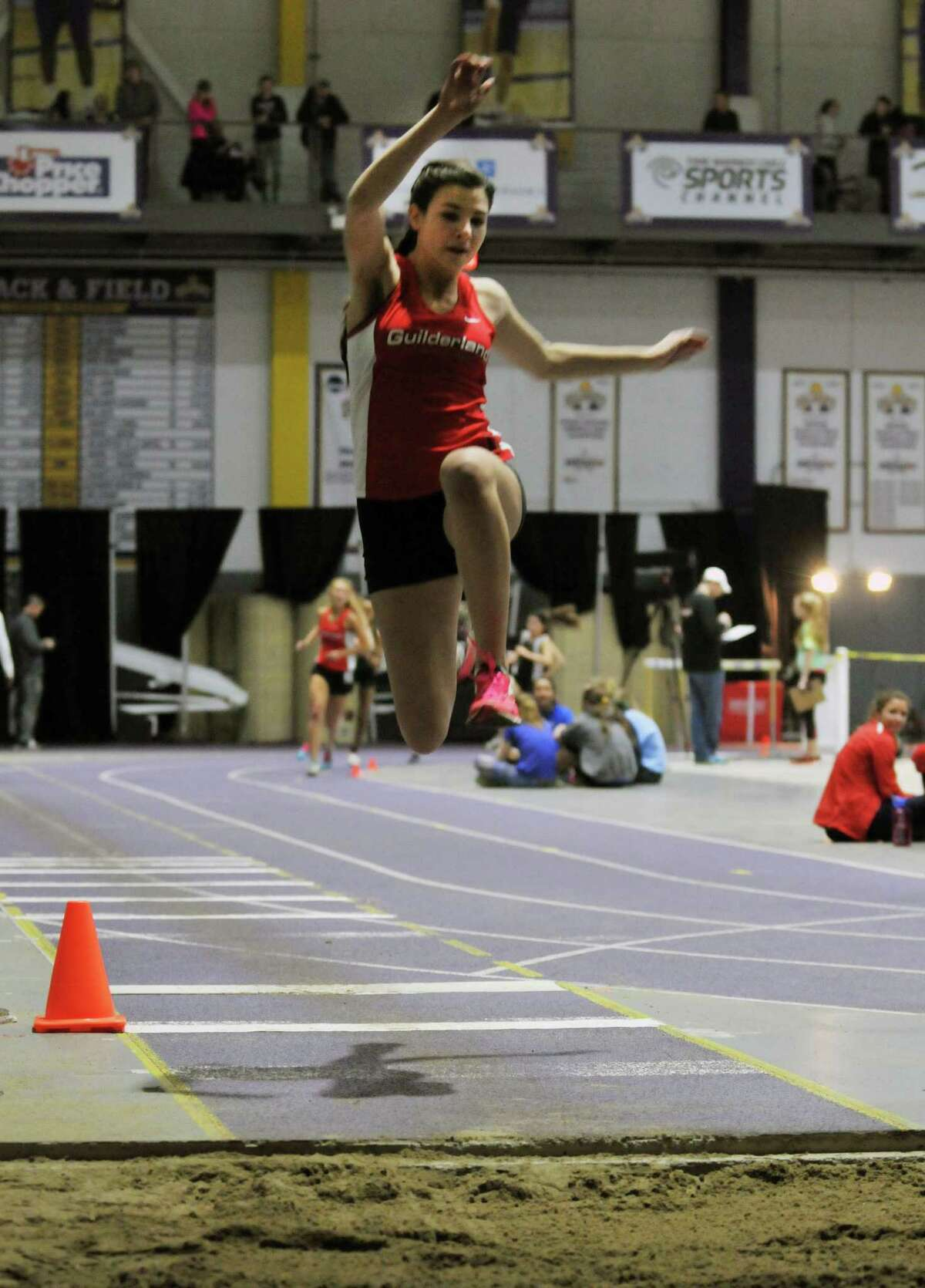 Bella Bruno of Guilderland High School leaps into first place with her 16-foot 9 1/2-inch jump in the girl's long jump during the Section II Division I championships for high school track in the SEFCU Arena on Friday, Feb. 19, 2016, in Albany, N.Y. (Brittany Gregory / Special to the Times Union)
