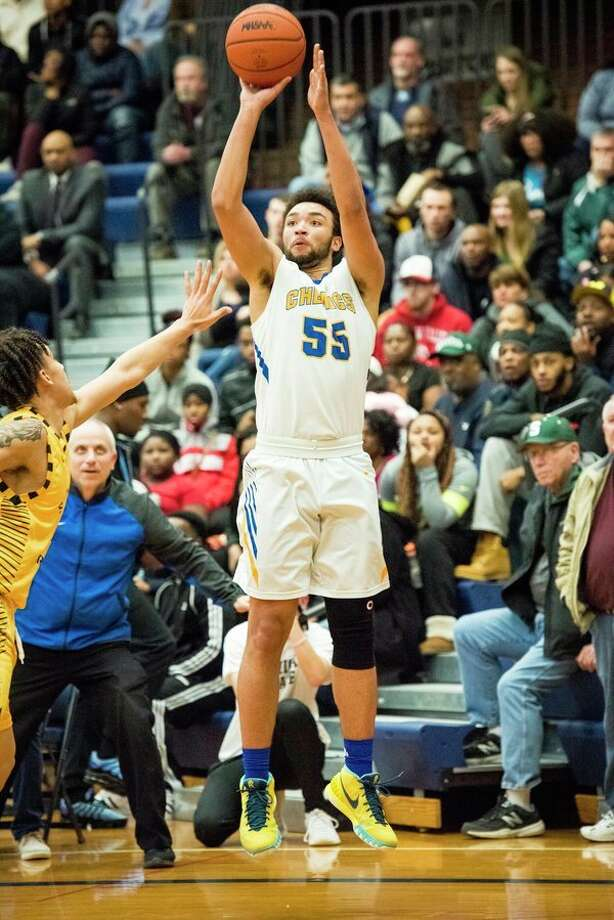 Midland senior Isaiah Bridges takes a shot during the Division 1 regional final on Friday in Saginaw. (Danielle McGrew Tenbusch/for the Daily News)